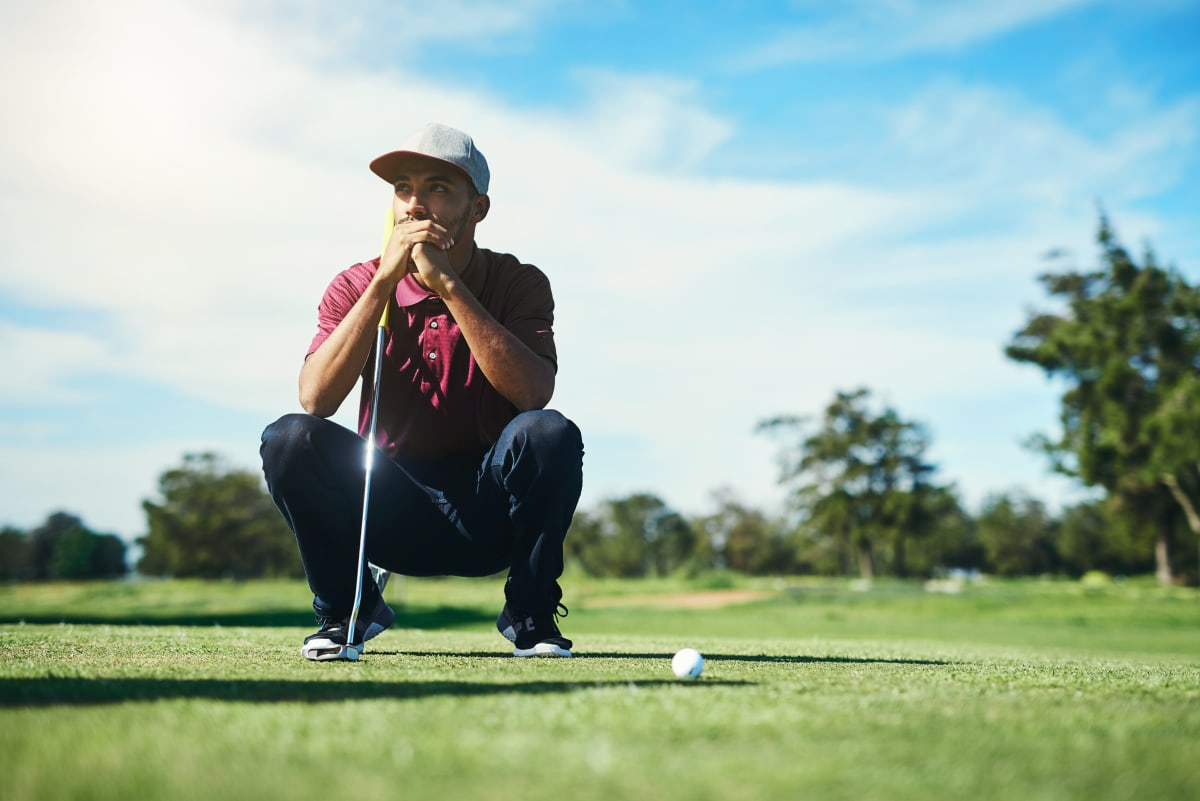man thinking about how to hit a golf shot